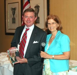 President Susan Schwall presents award to Carter Stout