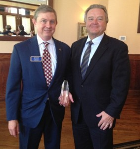 Carter Stout receives Member of Distinction Award from Tim Ramsey